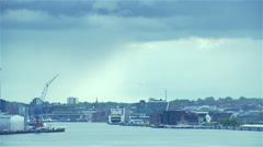 rainy clouds moving over sea port - stock footage