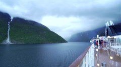 Passenger ship sailing in hurriedly fjords Stock Footage