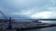 Rainy clouds moving fast over sea port Stock Footage