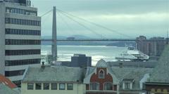 Ship sailing under a bridge in Stavanger Norway Stock Footage