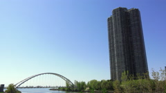 Suspension Bridge and High-Rise Building - stock footage
