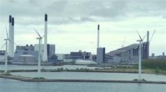 wind turbines for green energy and modern plant on the shore of the Sea - stock footage