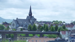 Old stone church with bridge and rushing clouds over Stavanger Stock Footage