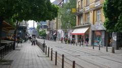 Walking cozy city center of Sofia Bulgaria - tram goes glide camera movement - stock footage