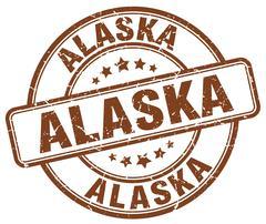 Alaska brown grunge round vintage rubber stamp - stock illustration