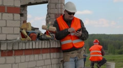 Glad builder using tablet PC - stock footage