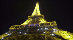 Eiffel Tower shimmering in darkness, worldwide known sight in Paris, France Stock Footage