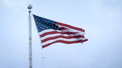 AMERICAN FLAG establishing shot sunset 240 fps slow motion - stock footage