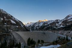 Mountain hydro dam in the morning. - stock photo