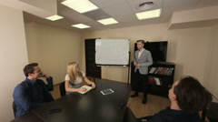 Briefing of young business team in a meeting room Stock Footage