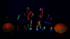 Dance group in neon costumes - stock footage