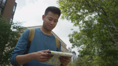 4K Young tourist with map, sightseeing in the city of London Stock Footage