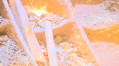 Bright Spark Pour in Stone Ground. Welding Works. Closeup Stock Footage