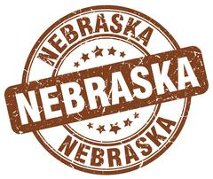 Nebraska brown grunge round vintage rubber stamp - stock illustration