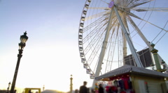 People enjoying leisure in crowded theme park, huge observation wheel rotating Stock Footage