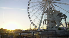 Sun going down in Paris, big wheel in Tuileries Garden, Eiffel Tower in distance Stock Footage