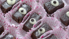Tasty chocolate brownies cupcake rotating, background Stock Footage