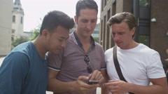 4K Happy casual male friends using wireless technology Stock Footage