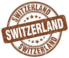 Switzerland brown grunge round vintage rubber stamp - stock illustration