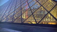 Happy couple enjoying a stroll outside Louvre Palace, viewing glass pyramids Stock Footage