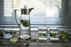 clean clear water with ice and mint leaves. close-up - stock photo