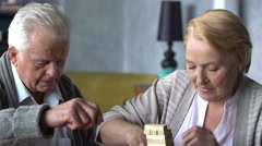 Elderly couple playing Board games Stock Footage