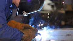 Welder at work in metal industry - stock footage