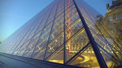 Pyramid at Louvre Museum in Paris, modern and classical architecture ensemble Stock Footage