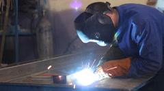 Welder at work in metal industry - stock footage