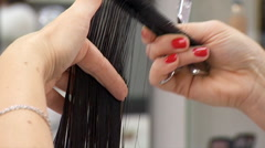 Cutting Dark Female Hair Stock Footage