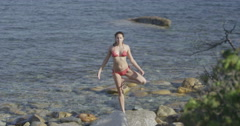 4K Beautiful woman doing yoga at the beach - stock footage