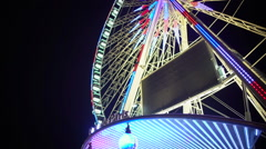 Rue de Paris wheel rotating, amusement ride for night cityscape observation Stock Footage