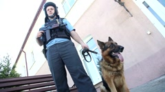 A police officer with a gun and a dog Stock Footage
