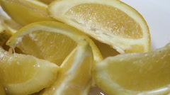 freshly sliced lemon wedges falling into water slow motion - stock footage