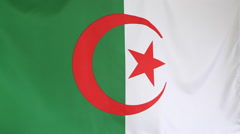 Textile flag of Algeria in slow motion Stock Footage
