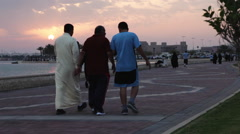 People walking on the Corniche - Sea coast at Sunset in a muslim country 02 Stock Footage