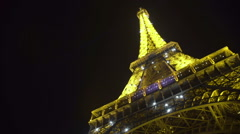 Romantic night in Paris, illuminated Eiffel Tower shimmering, travel to France Stock Footage