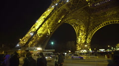 Many people at tourism center in Paris, Eiffel Tower bottom, sightseeing tour Stock Footage