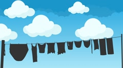 Clothes Hanging to Dry on a Rope on a Blue Sky Background Stock Footage