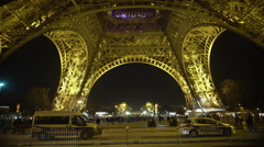 Police cars at bottom of Eiffel Tower, guarding public order in night Paris Stock Footage