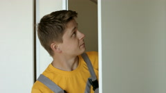 Young Man in Uniform Concentration Checks His Work. the Installation of Stock Footage