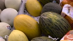 Assorted gourd melon squash at market - fruit vegetable stand - stock footage