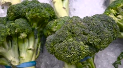 Assorted Broccoli at market - fruit vegetable stand - stock footage