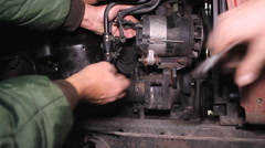 Worker repair the engine of the tractor  Stock Footage
