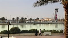 People walking in the corniche, in front the airport - Bahrain 01 - stock footage