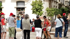 Sculpture of painter Pablo Ruiz Picasso with tourists - stock footage