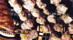 Gas barbeque full of different treats, including corn, sausage, bratwurst, ch Stock Footage