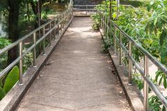Modern walkway bridge with metal railing. - stock photo