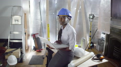 4k Confident female engineer or architect working at construction site Arkistovideo