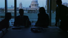 4K Business group in silhouette shake hands at the end of a meeting - stock footage